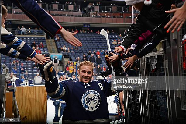James Wisniewski of the Columbus Blue Jackets highfives fans after pre game warmups before a game against the Nashville Predators on November 27 2013...