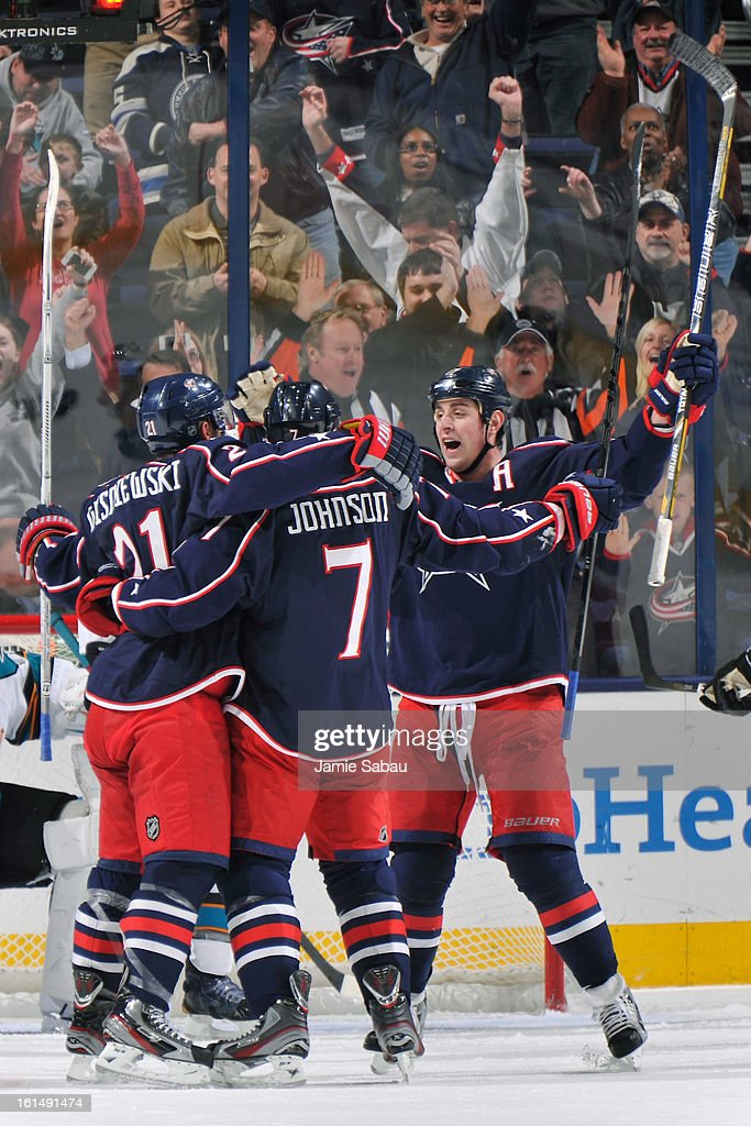 <a gi-track='captionPersonalityLinkClicked' href=/galleries/search?phrase=James+Wisniewski&family=editorial&specificpeople=688111 ng-click='$event.stopPropagation()'>James Wisniewski</a> #21 of the Columbus Blue Jackets is congratulated by his teammates after scoring a power play goal against the San Jose Sharks during the second period on February 11, 2013 at Nationwide Arena in Columbus, Ohio.