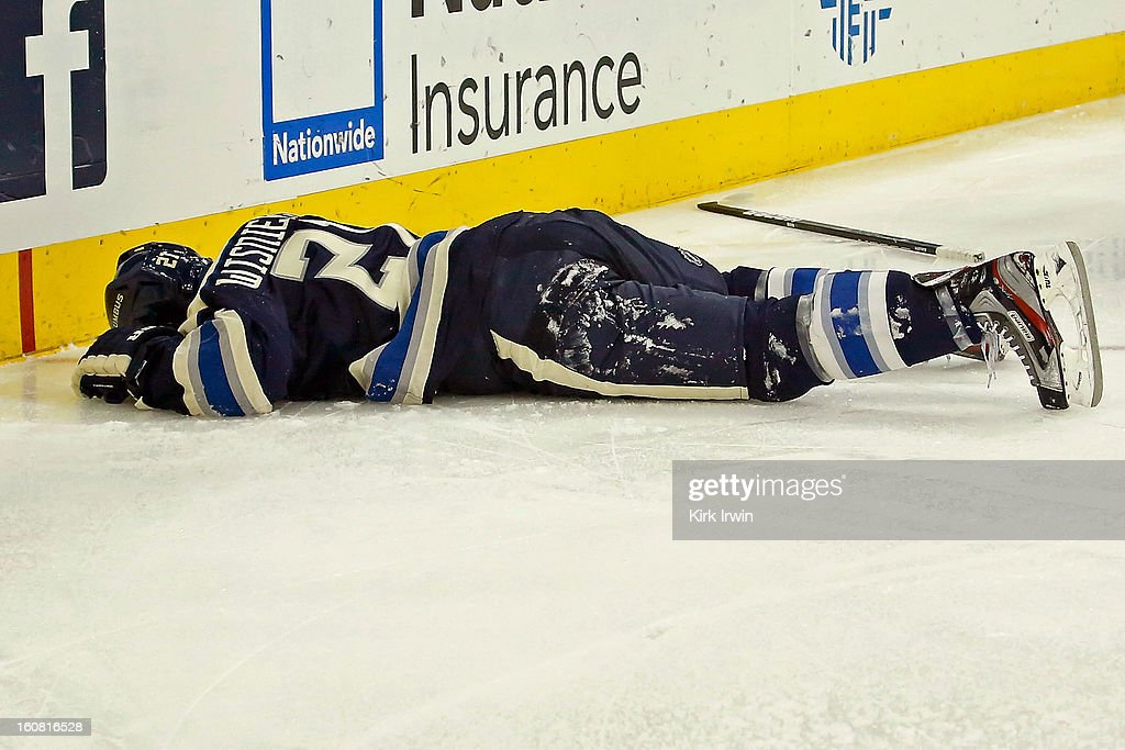 James Wisniewski #21 of the Columbus Blue Jackets lies on the ice after being injured while falling into the boards during the game against the Detroit Red Wings on February 2, 2013 at Nationwide Arena in Columbus, Ohio.