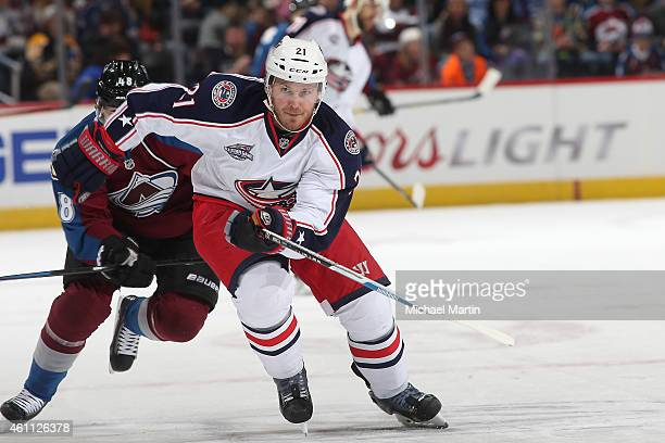 James Wisniewski of the Columbus Blue Jackets skates for the puck as he is pursued by Daniel Briere of the Colorado Avalanche at the Pepsi Center on...
