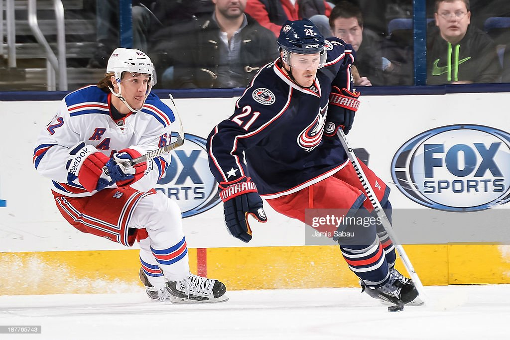 James Wisniewski #21 of the Columbus Blue Jackets skates with the puck as Carl Hagelin #62 of the New York Rangers gives a chase on November 7, 2013 at Nationwide Arena in Columbus, Ohio.
