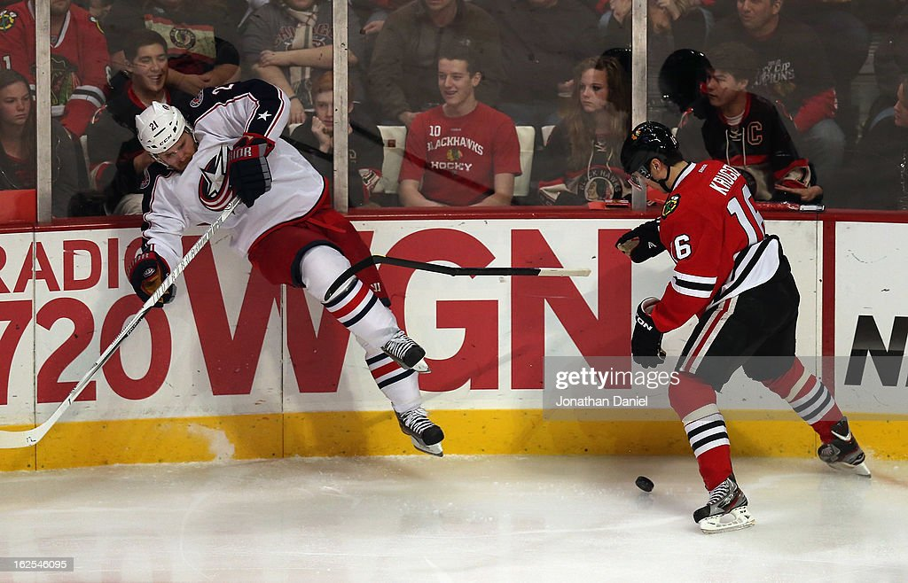 James Wisniewski #21 of the Columbus Blue Jackets slips and kicks the stick away from Marcus Kruger #16 of the Chicago Blackhawks at the United Center on February 24, 2013 in Chicago, Illinois.