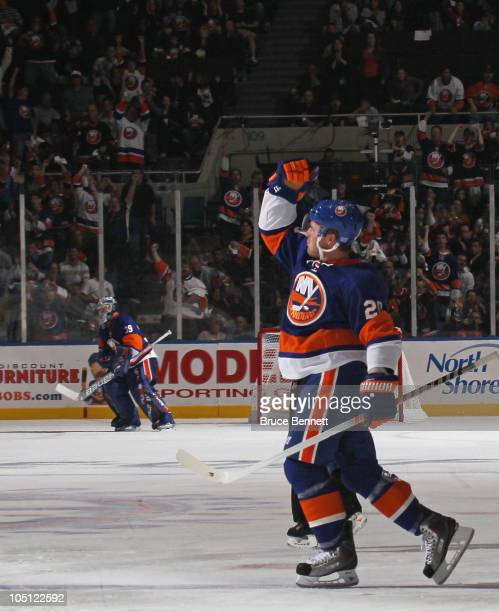James Wisniewski of the New York Islanders scores a power play goal at 621 of the seocnd period against the Dallas Stars at the Nassau Coliseum on...
