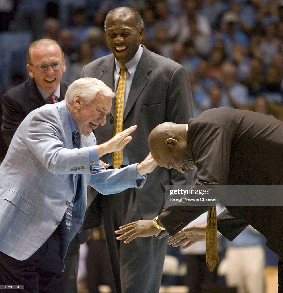 James Worthy and his former coach Dean Smith bow to honor each