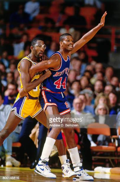 James Worthy of the Los Angeles Lakers fights for the position against Sidney Green of the New York Knicks during a game played circa 1989 at the...