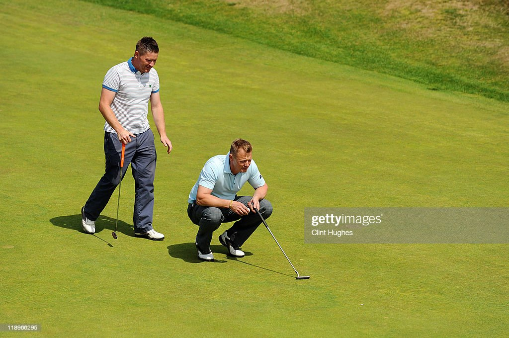 James Wright (L) and Andy Davies of Swindon Golf Club line up a putt on the ninth green during the Virgin Atlantic PGA National Pro-Am Championship - Regional at St Annes Old Links Golf Club on July 13, 2011 in Lytham St Annes, England