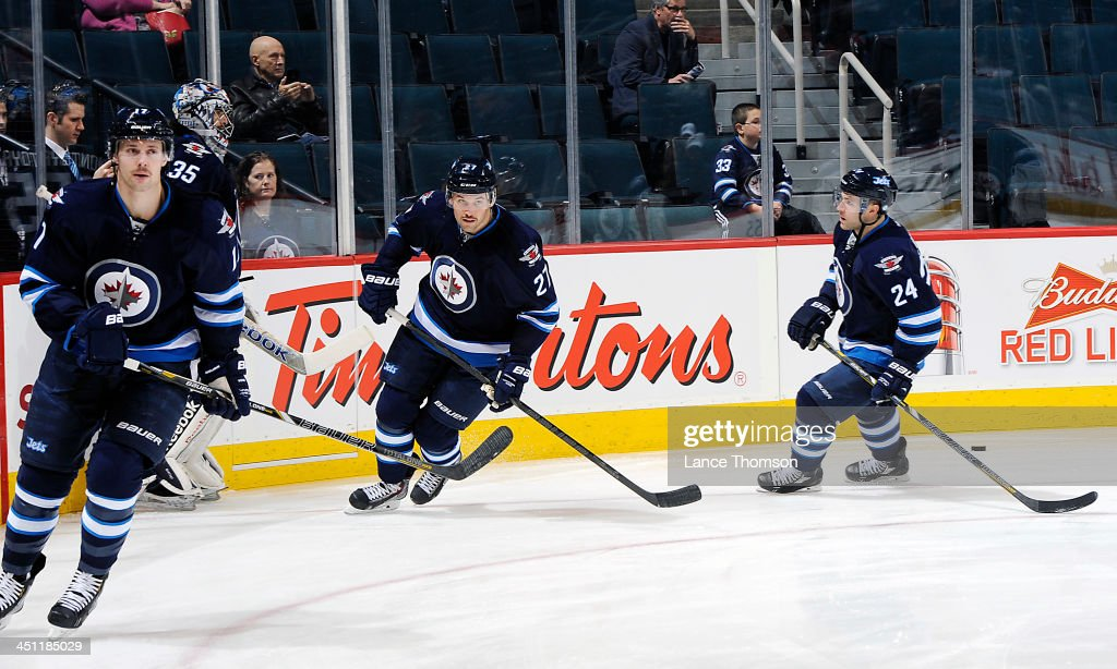 James Wright Eric Tangradi and Grant Clitsome of the Winnipeg Jets take part in the pregame warm up prior to NHL action against the Chicago...