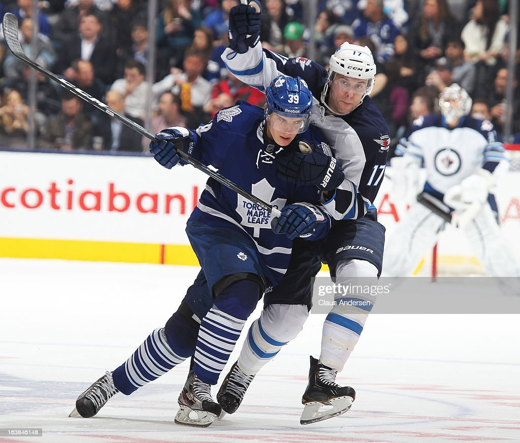 James Wright #17 of the Winnipeg Jets battles against <a gi-track='captionPersonalityLinkClicked' href=/galleries/search?phrase=Matt+Frattin&family=editorial&specificpeople=5648435 ng-click='$event.stopPropagation()'>Matt Frattin</a> #39 of the Toronto Maple Leafs in a game on March 16, 2013 at the Air Canada Centre in Toronto, Ontario, Canada. The Jets defeated the Leafs 5-4 in an overtime shoot-out.