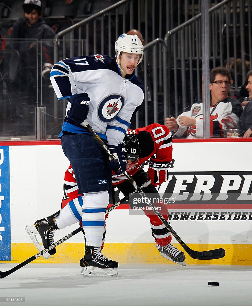 James Wright #17 of the Winnipeg Jets skates against the New Jersey Devils at the Prudential Center on November 25, 2013 in Newark, New Jersey. The Jets defeated the Devils 3-1.