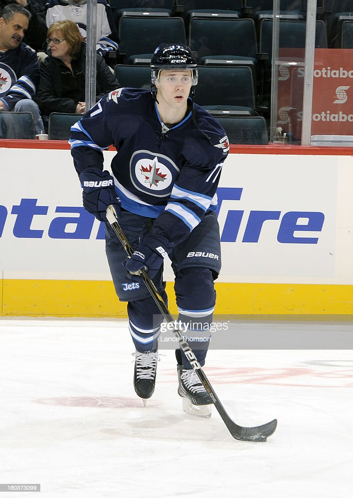 James Wright #17 of the Winnipeg Jets takes part in the pre-game warm up prior to an NHL game against the Pittsburgh Penguins at the MTS Centre on January 25, 2013 in Winnipeg, Manitoba, Canada.
