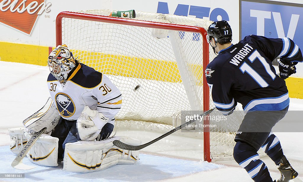 James Wright #17 of the Winnipeg Jets watches as a shot by teammate Aaron Gagnon #21 (not shown) goes into the net behind goaltender Ryan Miller #30 of the Buffalo Sabres for a second period goal at the MTS Centre on April 9, 2013 in Winnipeg, Manitoba, Canada.