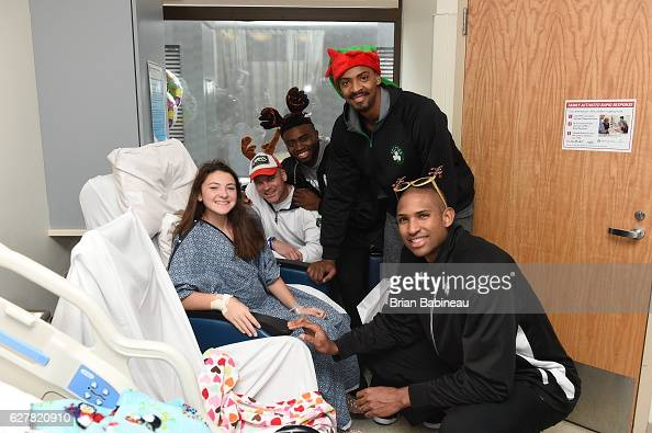 James Young Al Horford and Jaylen Brown of the Boston Celtics spread holiday cheer duing a children's hospital visit on December 1 2016 at Boston...