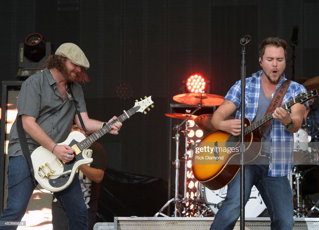 James Young and Mike Eli of Eli Young Band perform at Country Thunder USA - Day 2 on July 25, 2014 in Twin Lakes, Wisconsin.