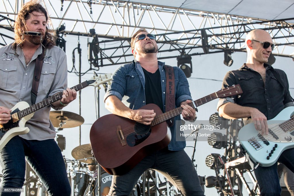 James Young, Mike Eli and Jon Jones of the Eli Young Band perform at Coastal Country Jam at Huntington State Beach on September 23, 2017 in Huntington Beach, California.