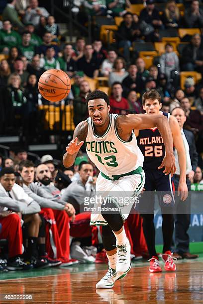 James Young of the Boston Celtics chases the ball against the Atlanta Hawks during the game on February 11 2015 at TD Garden in Boston Massachusetts...