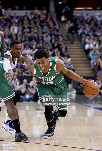 James Young of the Boston Celtics dribbles past Ben McLemore of the Sacramento Kings at Sleep Train Arena on February 20 2015 in Sacramento...