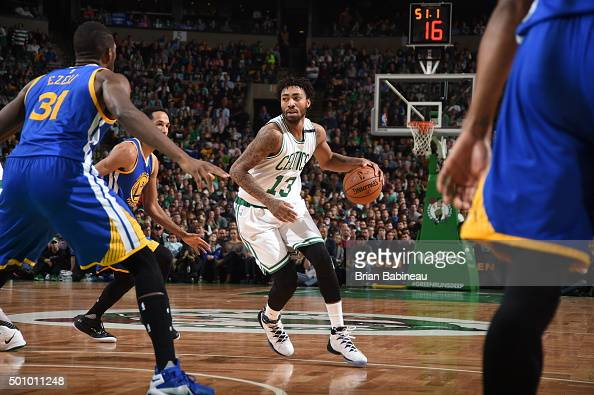 James Young of the Boston Celtics dribbles the ball against the Golden State Warriors on December 11 2015 at the TD Garden in Boston Massachusetts...