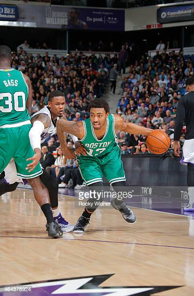 James Young of the Boston Celtics drives against Ben McLemore of the Sacramento Kings on February 20 2015 at Sleep Train Arena in Sacramento...
