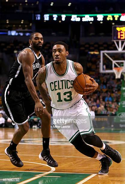 James Young of the Boston Celtics drives to the basket against Alan Anderson of the Brooklyn Nets in the first half during a preseason game at TD...