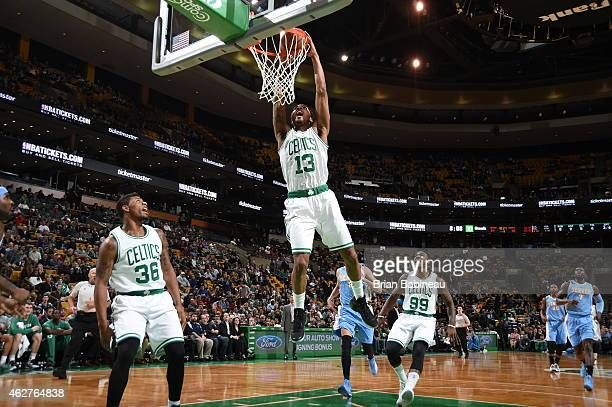 James Young of the Boston Celtics dunks against the Denver Nuggets on February 4 2015 at TD Garden in Boston Massachusetts NOTE TO USER User...