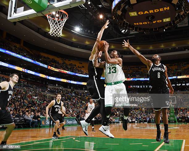 James Young of the Boston Celtics goes for a layup against the Brooklyn Nets during the game on October 22 2014 at the TD Garden in Boston...