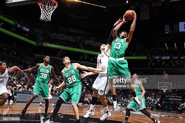 James Young of the Boston Celtics grabs the rebound against the Brooklyn Nets during the preseason game on October 14 2015 at Barclays Center in...