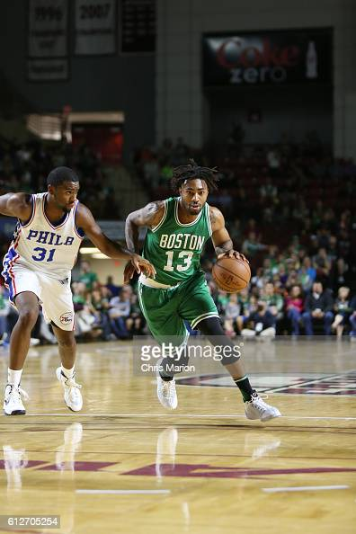 James Young of the Boston Celtics handles the ball against the Philadelphia 76ers during a preseason game on October 4 2016 at the Mullins Center in...