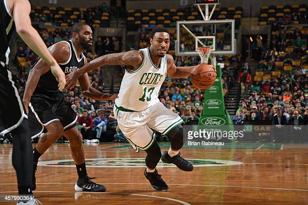 James Young of the Boston Celtics handles the ball against the Brooklyn Nets on October 22 2014 at the TD Garden in Boston Massachusetts NOTE TO USER...