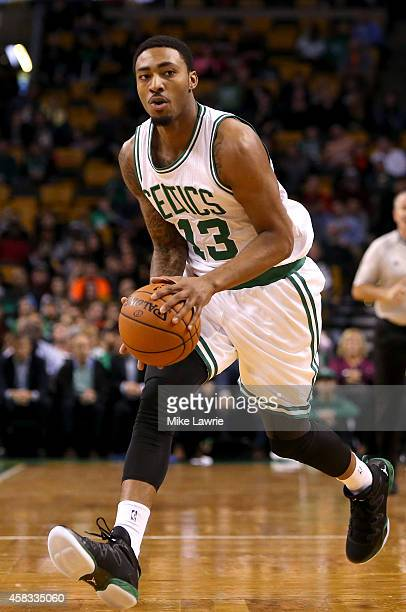 James Young of the Boston Celtics handles the ball against the Brooklyn Nets during a preseason game at TD Garden on October 22 2014 in Boston...