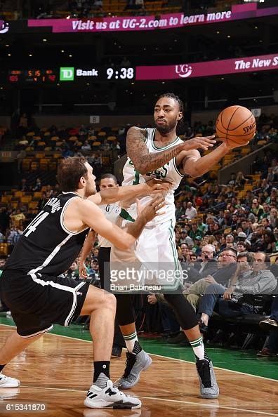 James Young of the Boston Celtics handles the ball against the Brooklyn Nets on October 17 2016 at the TD Garden in Boston Massachusetts NOTE TO USER...