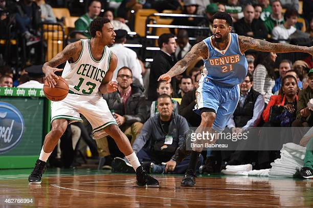 James Young of the Boston Celtics handles the ball against Wilson Chandler of the Denver Nuggets on February 4 2015 at TD Garden in Boston...