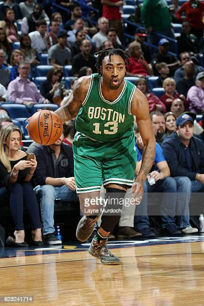 James Young of the Boston Celtics handles the ball during the game against the New Orleans Pelicans on November 14 2016 at Smoothie King Center in...