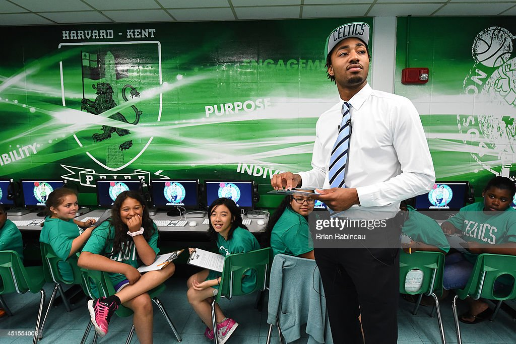 James Young of the Boston Celtics helps unveil a renovated technology lab on June 30, 2014 at Harvard Kent Elementary School in Charlestown, Massachusetts .