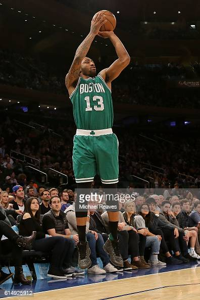 James Young of the Boston Celtics shoots a three against the New York Knicks during the second half of their preseason game at Madison Square Garden...