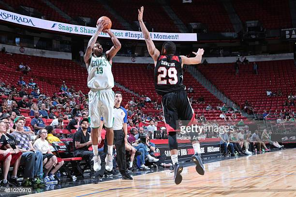 James Young of the Boston Celtics shoots against Andre Dawkins of the Portland Trail Blazers during the game on July 16 2015 at Thomas And Mack...
