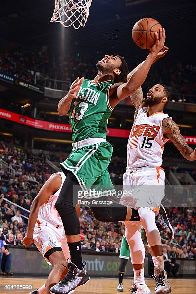 James Young of the Boston Celtics shoots the ball against Marcus Morris of the Phoenix Suns on February 23 2015 at US Airways Center in Phoenix...
