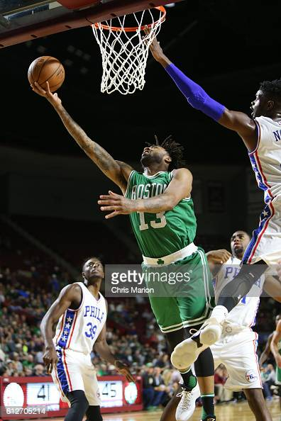 James Young of the Boston Celtics shoots the ball against the Philadelphia 76ers during a preseason game on October 4 2016 at the Mullins Center in...