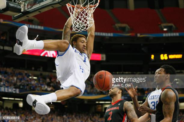 James Young of the Kentucky Wildcats dunks the ball against the Georgia Bulldogs during the semifinals of the SEC Men's Basketball Tournament at...