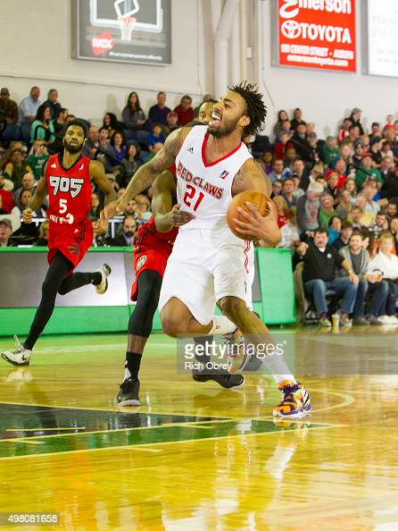 James Young of the Maine Red Claws is fouled by the Toronto Raptors 905 in their home opener on November 20 2015 at the Portland Expo in Portland...