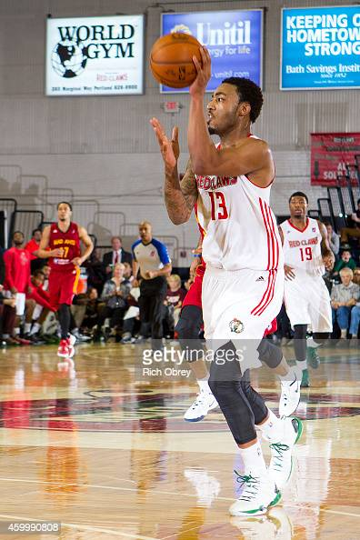 James Young of the Maine Red Claws throws an alleyoop pass on the fast break to teammate Jermaine Taylor during the game against the Fort Wayne Mad...