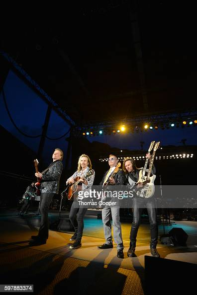 James Young Tommy Shaw lead singer of Styx Chuck Panozzo original bass player and Ricky Phillips play with the Colorado Symphony at Red Rocks...