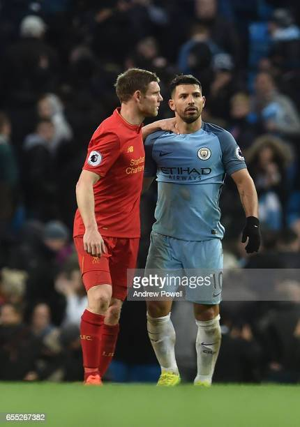 JamesMIlner of Liverpool with sergio Aguero of Man City at the end of the Premier League match between Manchester City and Liverpool at Etihad...
