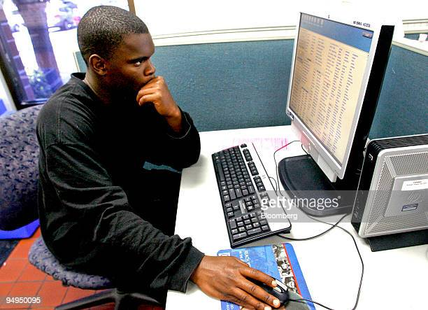 Jameson Canady who has been out of work for four months surfs the Craigslist Web site for jobs at the Employment Development Department office in...