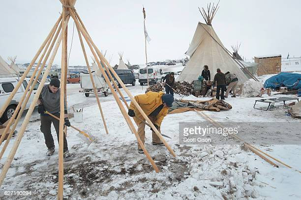 Jameson Dargen of Fargo North Dakota and Peter Anderson of Fairfax California build a tipi at Oceti Sakowin Camp on the edge of the Standing Rock...