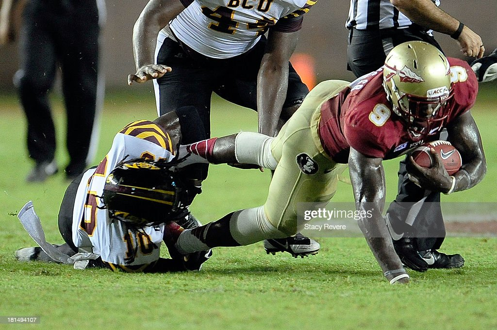 Jameson Wright #10 of the Bethune-Cookman Wildcats tackles Karlos Williams #9 of the Florida State Seminoles during a game at Doak Campbell Stadium on September 21, 2013 in Tallahassee, Florida.