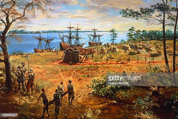 Three ships lie at anchor on the river as early settlers carry lumber and raise the walls of the stockade fort at Jamestown Virginia the first...