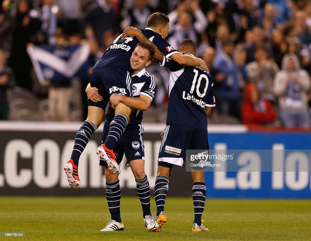 JamesTroisi (L) of the Victory celebrates a goal with team -mates during the round four A-League match between Melbourne Victory and Wellington Phoneix at Etihad Stadium on November 4, 2013 in Melbourne, Australia.