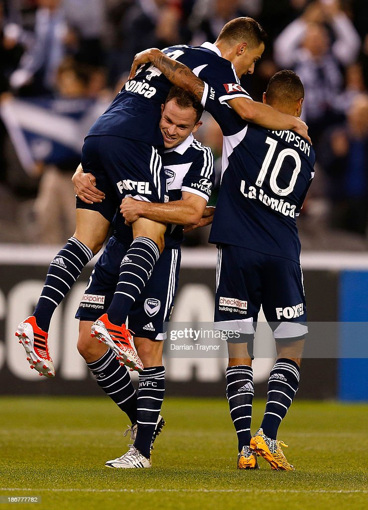 JamesTroisi (L) of the Victory clebrates a goal with team-mates during the round four A-League match between Melbourne Victory and Wellington Phoneix at Etihad Stadium on November 4, 2013 in Melbourne, Australia.