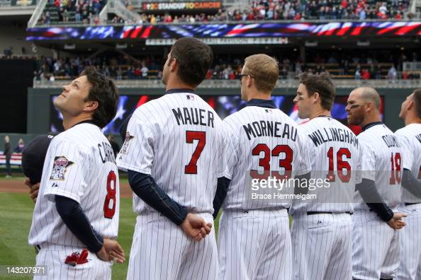Jamey Carroll Joe Mauer Justin Morneau and Josh Willingham of the Minnesota Twins stand during the national anthem prior to the game against the Los...