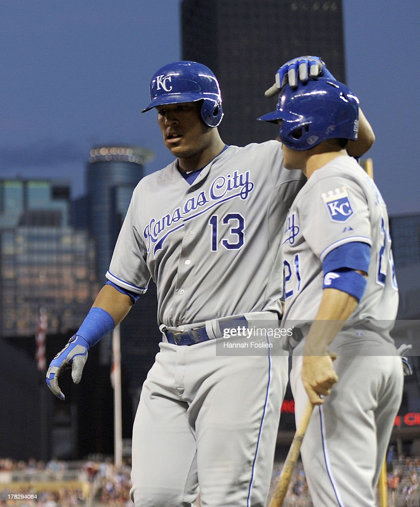 Jamey Carroll #21 of the Kansas City Royals congratulates teammate Salvador Perez #13 on a two run home run against the Minnesota Twins during the fourth inning of the game on August 28, 2013 at Target Field in Minneapolis, Minnesota.